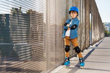 Cute roller skater in helmet at outdoor rollerdrom