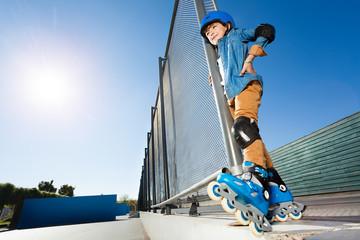 Inline skater in protective gear at skate park