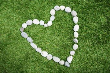 Heart shape made of pebble stones