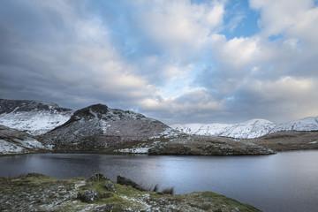 Beautiful long exposure Winter landscape image of Llyn y Dywarchen in Snowdonia National Park