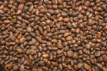Not a lot of shelled pine nuts - background