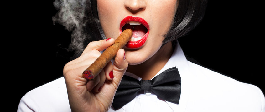 Beutiful woman smoking cigar with red lips banner