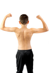 Shirtless teenage boy flexing his back muscles