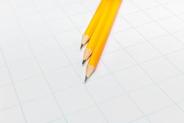 Three yellow pencil on white paper