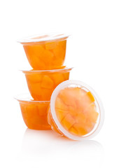 Single cups with peach in fruit jelly