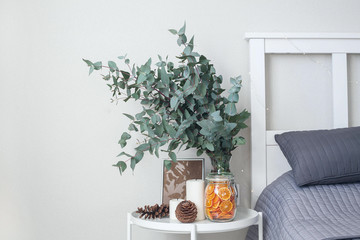 Eucalyptus in the interior, in the bedroom by the bed.