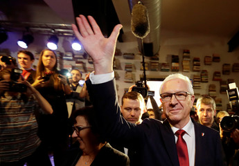 Czech presidential candidate Jiri Drahos waves to his supporters, after polling stations closed for the country's direct presidential election, in Prague