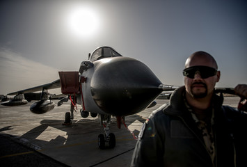 A German air force pilot stands next to a fighter jet during a visit of Defence Minister Ursula von der Leyen at the Al Azraq air base in Jordan