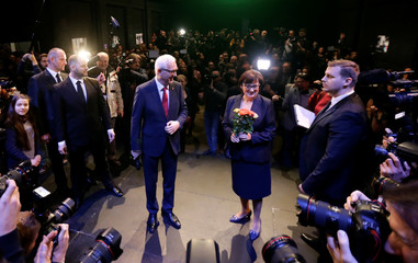 Czech presidential candidate Jiri Drahos pose for photos with his wife Eva at his headquarters, after polling stations closed for the country's direct presidential election, in Prague