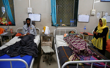 Survivors receive medical treatment, after a ferry boat carrying schoolchildren sank in the Arabian Sea, at a hospital in Dahanu
