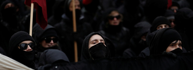 Protestors attend an anti-government demonstration in Vienna