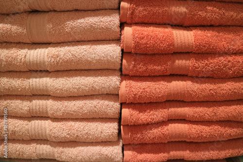Stack Of Pastel Orange And Deep Orange Color Folded Bath Towels