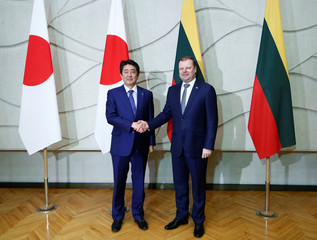 Lithuania's PM Skvernelis and Japan's PM Abe shake hands during their meeting in Vilnius