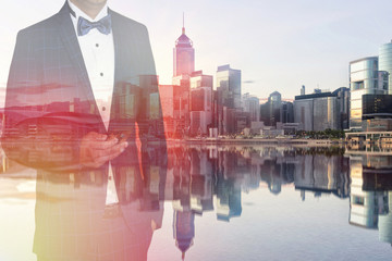 Double exposure of businessman using smart phone with cityscape and financial graph on blurred building background, Business Trading concept