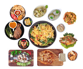 Food is sacred in the Chinese new year, such as fish, pork, shrimp, crab, bamboo shoots, tofu, desserts and fried yellow noodle in  Chinese style placed on red velvet cloth.