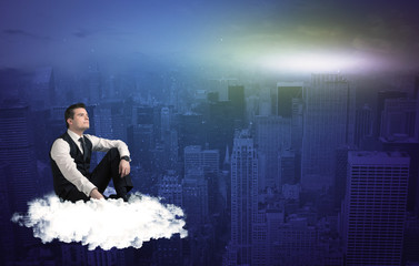 Man sitting on a cloud above the city