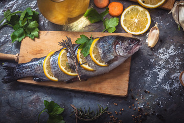Salmon on rustic table with fresh ingredients for cooking
