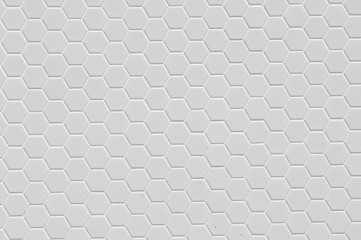 A simple white texture pattern of hexagons as a background