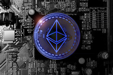 ethereum coin on an computer motherboard blue style
