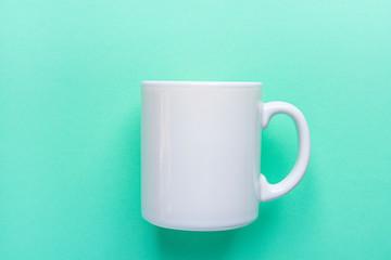 Blank White Mug Mockup on Light Turquoise Background. Template Space for Creative Artwork Lettering Text Product Promotion Branding. Elegant Feminine Style Flat Lay