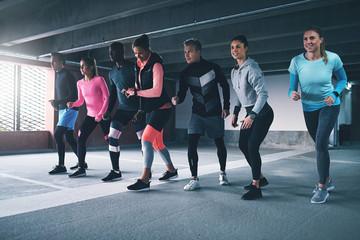 Sportsmen getting ready to run. Wall mural