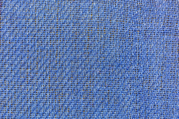 Background, texture, blue fabric closeup with interwoven strands
