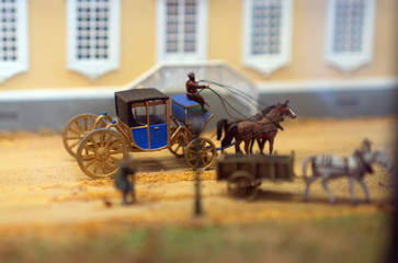 The world in miniature. The coach is on the street.