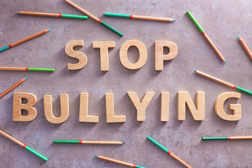 "Text ""Stop bullying"" on grey background"