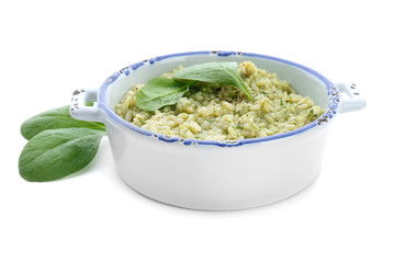 Dish with tasty spinach risotto on white background