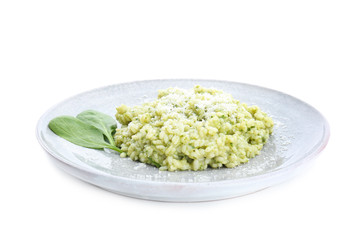 Plate with tasty spinach risotto on white background
