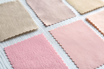 Colorful fabric samples on light background