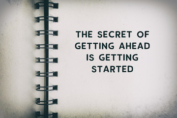 Inspirational Quote - The secret of getting ahead is getting started. Blurry retro background.
