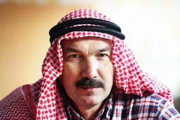 Serious arab man in arab kerchief