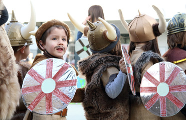 children with viking costumes in a show at the school