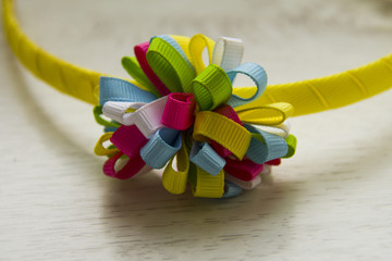 multicolored knot of ribbons on the headband