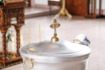 baptismal font. Accessories for the christening of children icons of candles, the Ortodox Church. The Sacrament of Children