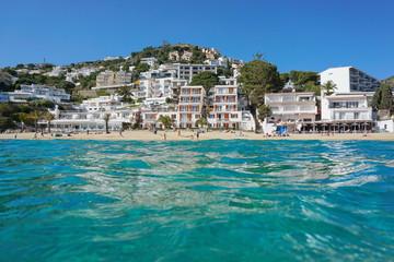 Spain Costa Brava coastline, Mediterranean beach with buildings, seen from sea surface, playa Almadrava, Canyelles Grosses, Roses, Girona, Catalonia