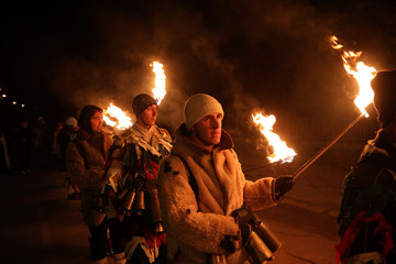 """Men dressed in costumes made of animal fur called """"kuker"""", take part in a festival in the village of Dragichevo"""