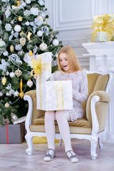 girl in xmas room