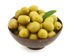 heap of olive in wooden bowl on white