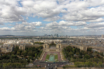 Aerial view over the city from the top of the Eiffel Tower in Paris, France. The Champ de Mars.