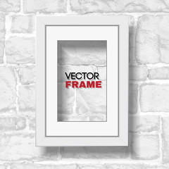 Rectangular a4 white picture frame with passepartout hanged on white modern brick wall