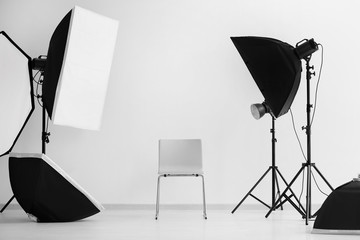 Interior of modern photo studio with chair and professional equipment Wall mural