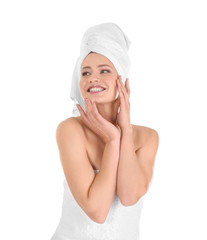 Attractive young woman in towel on white background