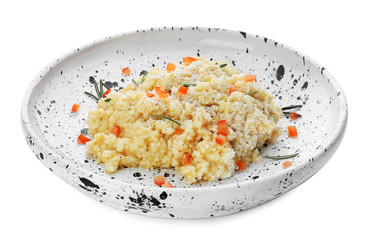 Plate with delicious risotto on white background