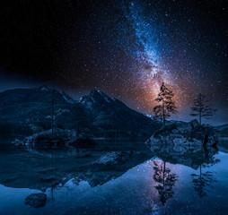 Fototapete - Milky way at Hintersee lake in Alps, Germany