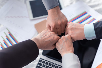 Asian team business and partners business giving fist bump after agreement deal complete, Business concept