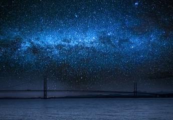 Fototapete - Milky way over bay in Queensferry, Scotland