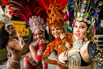 Wonderful Brazilian women wearing carnival costume