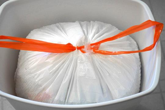 Top view of white plastic trash bag in the trash bin